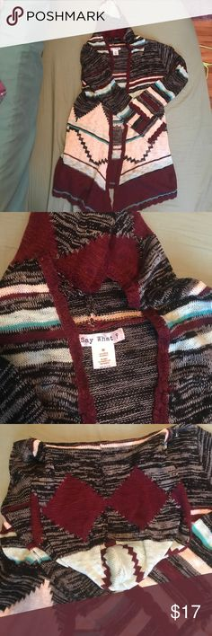Aztec pattern asymmetrical sweater NWOT I got it as a gift and just never found the right thing to wear it with. It's very soft and comfortable and in perfect condition. It's a beautiful maroon, cream, light and dark teal, and black. Would look very cute with skinny jeans and a pair of boots for fall! Say What? Sweaters Cardigans