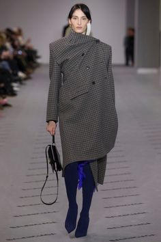 Checkered print draped coat over pointed toe boots from Balenciaga's fall-winter 2017 collection