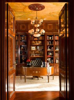 Home Office Ideas: map on ceiling, chandelier medallion, tufted leather chiar