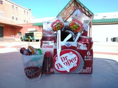 Gift Bucket contains 2 cans of pure cane Dr Pepper, 1 5oz Soda Popper Candy mix, 2 1 oz Dr Pepper Jelly Belly packet, 1 Dr Pepper Lip Smacker, 1 pair of Dr Pepper Museum sunglasses, 1 white I'm A pepper pencil, 1 white Dr Pepper Museum pencil, 1 red prism Dr Pepper Museum pencil - $15.95