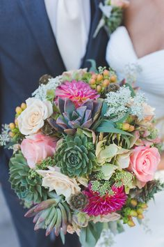 A bursting wedding bouquet with roses, dahlias and succulents! {Abbey Lunt Photography}