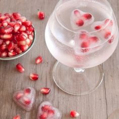 Add a bit of love to your glass of champagne on your special day with these easy and super cute pomegranate heart shaped ice cubes.