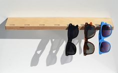 Looking around my apartment, I noticed that I had what seemed like a million sunglasses strewn all over. I needed a way to gather all my glasses into one place. This Sunglass Holder is a simple, cool way to organize your glasses. It can be mounted to any wall and used as a small shelf if desired. It is 1.5 feet long and includes the mounting pieces. It has 7 notches to hang glasses on.