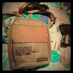 NWT. DIESEL Crossbody 7 Seas II Bag. Army Green. SOLD OUT in stores and online! This unisex bag is simple and stylish. It features a clear ID pocket in front, double zip main compartment with a inside pocket large enough for cell phone, keys, make-up...Truely a GREAT daytime bag!! Diesel Bags Crossbody Bags