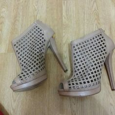 REDUCED. !!!Micheal Kors High heels. Preownef. Size 8. It has little stains outside the shoes but not noticeable when you wear it. Some wear on sole. Michael Kors Shoes Heels