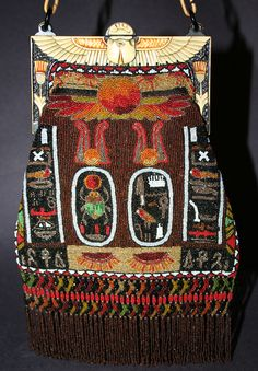 (Original caption - One of my favorite Egyptian Revival purses. It has a great celluloid frame with a winged scarab and a beaded purse with Egyptian hieroglyphs and a wonderfully complex fringe. Vintage Purses, Vintage Bags, Vintage Handbags, Vintage Outfits, Vintage Fashion, Beaded Purses, Beaded Bags, Art Deco Period, Textiles
