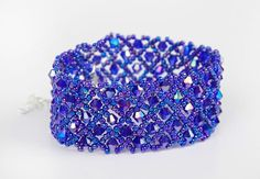 Unique handmade bracelet with Purple AB Bicones 4mm. Toho Round Purple11/0…