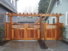 Out of all the cedar fence gate designs out there, this gorgeous, rustic wooden fence is the perfect touch as an entranceway to the garden! Fence gate ideas and design. Brick Fence, Front Yard Fence, Yard Gates, Fence Stain, Stone Fence, Pallet Fence, Pool Fence, Entrance Gates, Cedar Gate