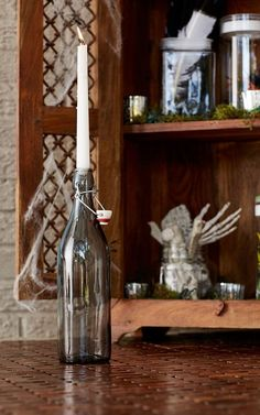 A candle in our Giara Water Bottle creates an instantly spooky centerpiece for your Halloween party!