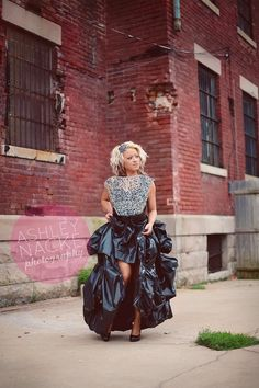 this dress is made completely of recycled products!! skirt-100% plastic and top is a mesh of wire, metals, and sequins  Photo by http://www.ashleynackephotography.com/