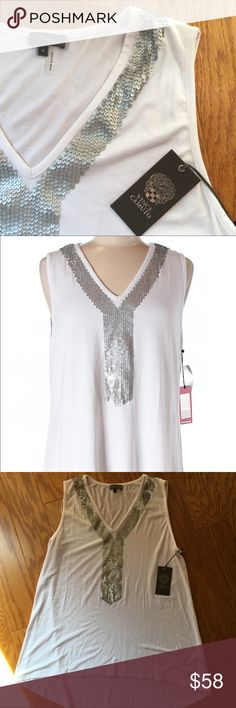 NWT Vince Camuto sleeveless top Brand new with tags Vince Camuto sleeveless top. Ultra white and silver sequins detailing.  Buy with confidence! ✔️ Top rated seller ✔️ Fast shipper (1 day) ✔️ Top 10% seller ✔️ Top 10% sharer ✔️ Posh Mentor Vince Camuto Tops Tank Tops