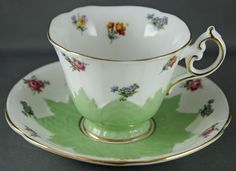 Paragon Bone China Tea Cup and Saucer Embossed Green with Mini Roses Violets