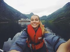 Kayaking in between cruise ships on the Geirangerfjord   Great photo by @hannebfit through #HellyHansen