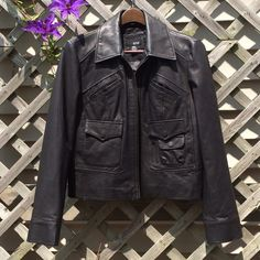 "Black leather jacket This is a black leather jacket by A New Approach size Large. I'm 5'7"" and the sleeves are just too long for me. The body fits true however do if you're tall this might be for you. Another wardrobe staple. ANA Jackets & Coats"