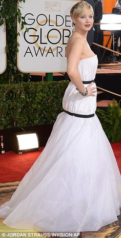 Jennifer Lawrence is wearing a Christian Dior 2013 dress from the Autumn collection.