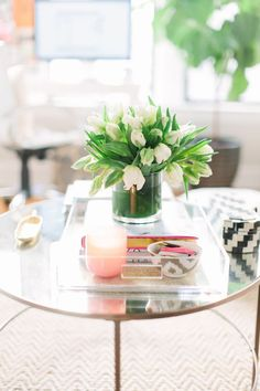 @Danielle Lampert Moss Chicago Home Tour // living room // side table // Parker & Rain lucite tray // fresh slowers //  photography by Stoffer Photography