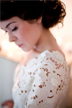 maybe you wanna try this kind of wedding dress? i want it.. cut off embroidery. white on white