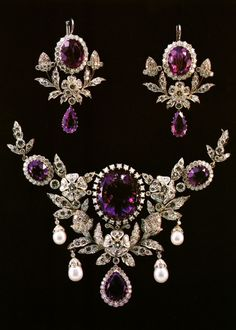 Beautiful antique amethyst and diamond jewelry set, source unknown.