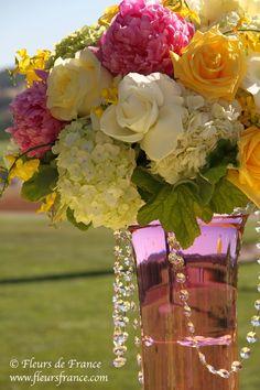 White, Pink & Yellow tall wedding reception centerpiece with Crystals. Chateau St. Jean Wedding, Sonoma. Floral Design: Fleurs de France. www.fleursfrance.com. Wedding Planner: www.a-dreamwedding.com
