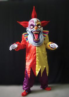 Colorful creepy clown suit includes tunic, pants, and collar, with oversized mask and hands. One size fits most adults.
