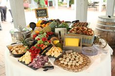 Perfect display of cheese, crackers, fruit, finger foods, etc. for a rustic, vineyard wedding reception.