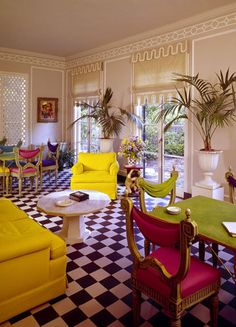 If it looks like the kind of space where Donatella Versace might throw a bridge party, consider this: Michael Taylor's card room for San Francisco client Maryon Davies Lewis was completed in 1963 — and has not been changed since. Working with the original checkerboard floor, Taylor created an explosion of color, covering ornate Venetian side chairs in electric shades of silk and adding upholstered pieces in lemon yellow.