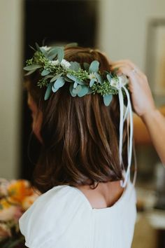 Flower girl head wreath of seeded eucalyptus and blossoms.