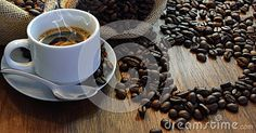 Cup of coffee with coffee beans heart shape