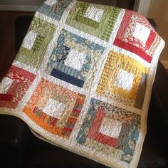 So cute and what an awesome way to use up scraps .. Wee play log cabin quilt