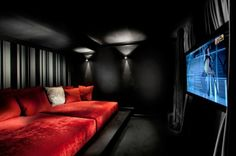 Theater room~I would have a different color scheme tho!!