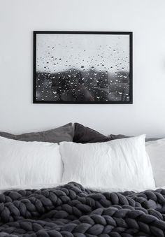 Minimalist Scandinavian bedroom. Linen bedding, chunky wool blanket from Ohhio, Rainy Day photo print by Anu Tammiste