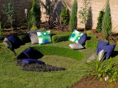 This sunken outdoor sofa is upholstered with grass and AstroTurf.