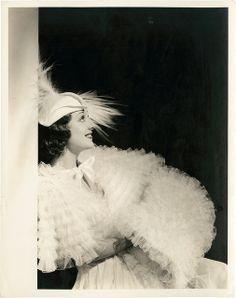 Ann Dvorak wearing a fluffy birthday cake.