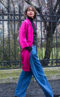This PFW attendee's hot red lip and fuschia jacket piqued our interest