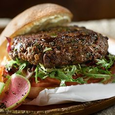 From the succulent beef to the sliced black olives and abundant herbs, there is absolutely nothing basic about this elegant burger.