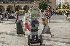 Man riding on Segway transports in the summer in the Old city of Krakow, Poland. Europe.