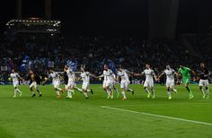 Juventus' players celebrate their 2-0 victory at the end of the the during the UEFA Champions League round of 16 second leg football match FC Porto vs Juventus at the Dragao stadium in Porto on February 22, 2017. / AFP / FRANCISCO LEONG
