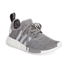 'nmd by adidas. Smart street style merges with technical sporty details in a lightweight, mesh running shoe featuring a boost midsole...