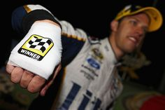 Brad Keselowski cuts hand on champagne bottle in victory lane ...