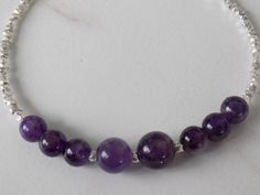 """Perfect Gift for you, your Valentine or a February Birthday! 7"""" sterling silver lobster clasp bracelet. The tiny nuggets are 2.5mm sterling silver and lovely 6mm and 8mm Amethyst beads. We finished it off with our signature pearl and 925 Pearlz tag. Nothing but the best from the Pearlzsisterz! #february=amethyst https://www.etsy.com/listing/221355142/februaryamethyst-sterling-lobster-clasp?ref=shop_home_active_1"""