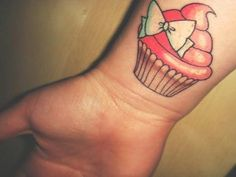 Cutesy cupcake tattoo