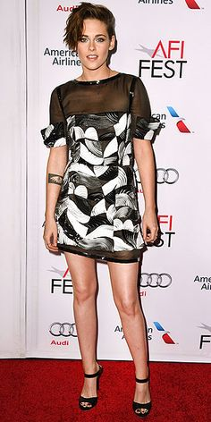 At a screening of Still Alice in Hollywood, the star chooses a black and white graphic-print Chanel mini with a sheer ...