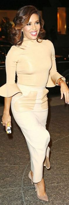 Who made Eva Longoria's tan leather pocket skirt and beige flare sleeve top?