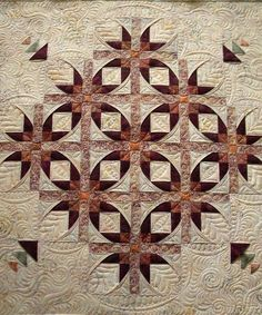 Mexican Stars quilt by Lisa, quilted by Jenny's Doodling Needle.  This quilt design is by Annette Ornelas.
