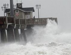 Large waves generated by hurricane Sandy crash into Jeanette's Pier in Nags Head, North Carolina