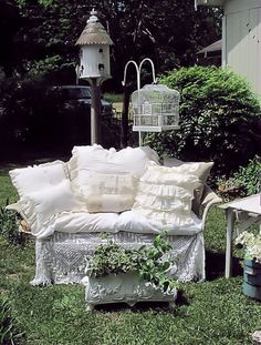 Use old, pink loveseat slipcover to cover the bench....then padding from old pillows, featherbeds, etc.,  Love the look!