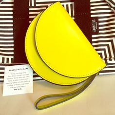 """✨Kate Spade SATURDAY rare leather wristlet! ✨Amazing neon yellow colored leather- with mirror on the inside!✨  Brand: Kate Spade Saturday Color: Neon yellow Lined in black& white print Details: Interior: Large mirror2 credit card slits & zip compartmentMagnetic closure Kate Spade SATURDAY embossed  Size: Almost 5""""L x 6.25W x 1.25 D Rare and in Amazing Condition  kate spade Bags"""