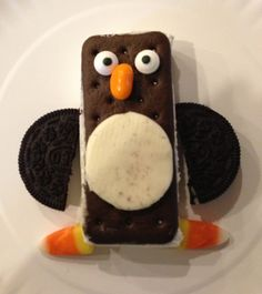 Penguin snack- mini ice cream sandwich, oreo wings.