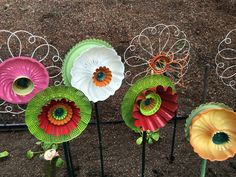 Up cycled yard art flowers jello mold bundt pan steamer baskets by Jeanette Crooks