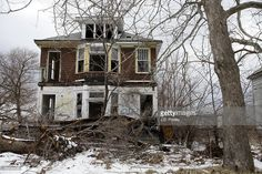 An abandoned home is seen on February 24, 2013 in Detroit, Michigan. The city of Detroit has faced serious economic challenges in the past decade, with a shrinking population and tax base while trying to maintain essential services. A financial review team issued a finding on February 19 identifying the city as being under a 'financial emergency.' Michigan Gov. Rick Snyder has 30 days from the report's issuance to officially declare a financial emergency, which could result in the governor…